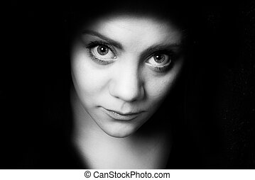 bigeye shy young woman who looks straight into the camera