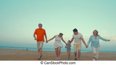 Bih happy family running on the beach