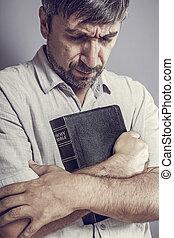 bijbel, vasthouden, man