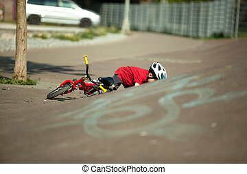 Bike Accident - A young Boy falls from his bike