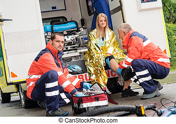 Bike accident woman emergency doctor checking leg
