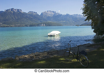 Bike, boat and lake Annecy - View of a bike just front lake...