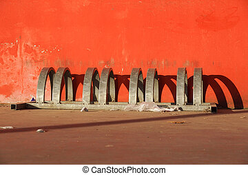 bike carrier . bicycle parking lot against red wall background