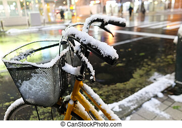 Bike covered with snow in the city. Winter in Hokkaido, Japan