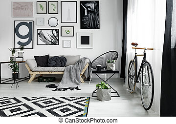 Bike in lounge - Old-fashioned bike in spacious modern ...