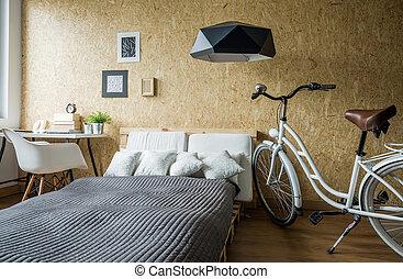 Bike in modern cozy bedroom - White girl's bike in modern...
