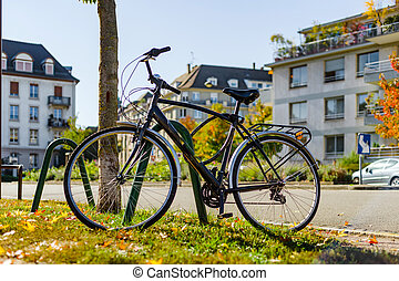 Bike in the autumnal city, street view, Strasbourg