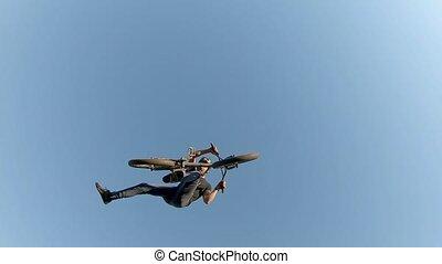 Bike jump over a dirt trail on a dirt track.