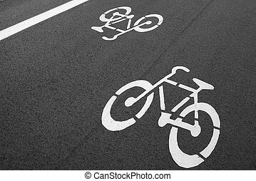 Bike lane. Sign for bicycle painted on the asphalt.