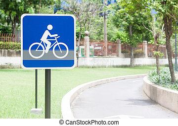 Bike lane sign in public park