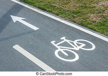 Bike lane sign on asphalt