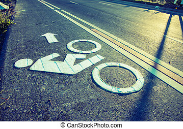 Bike lane sign on the road in count