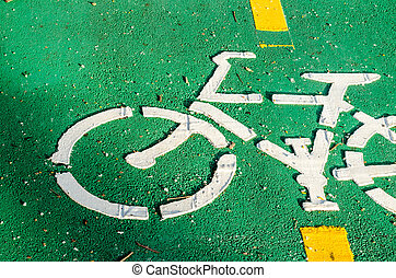 Bike lane sign painted on a street