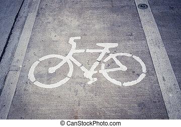 Bike Lane Symbol, Bicycle white sign on concrete road.