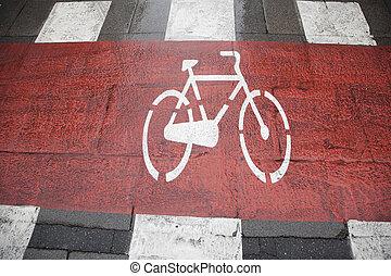 Bike lane symbol painted on street