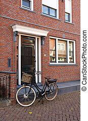 bike near brick wall