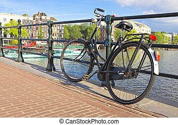 Bike on the bridge in Amsterdam the Netherlands