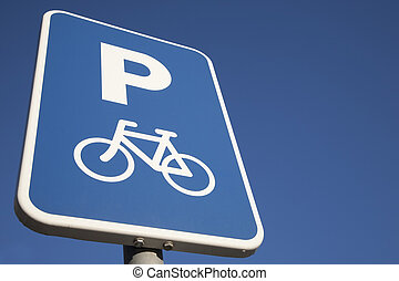 Bike Parking Sign against Blue Sky Background with Copy Space