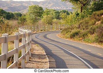 A bike path winds through the hills.