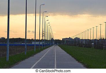 Bike path at sunset, outskirts of St. Petersburg, Russia.