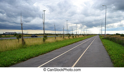Bike path in the vicinity of St. Petersburg at cloudy day, Russia.