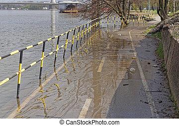 Flooded bike path along river Sava coast