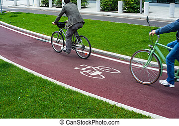 MILAN, ITALY - MAY 27: View two cyclists on the new bike path on May 27, 2014
