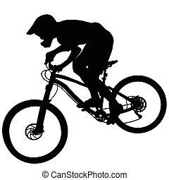 Bike race on a mountain slope - silhouette - Bike race on a...