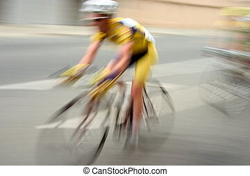 An intensional zoom-blur, gives this bike racer feeling of motion, and removes all the sponsors from his jersey.