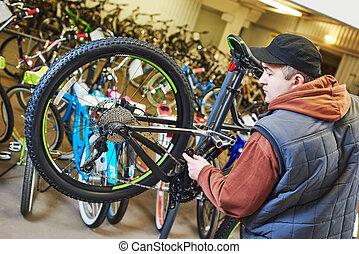bike repair or adjustment - Bike maintenance: mechanic...