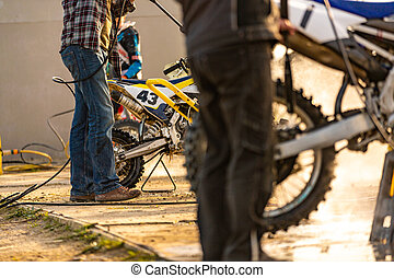 Bike rider washing his motorcycle