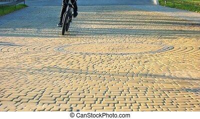 Bike riding on cobblestone pavement. Cycling on pavement.