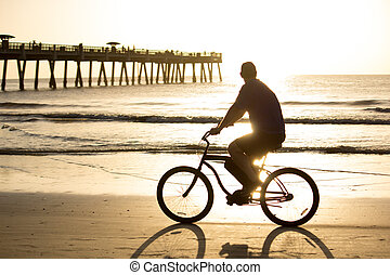 Bike Riding - Bike riding in early morning on the beach.
