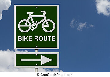 Bike Route Sign, An green road sign with bike icon and arrow with blue sky background