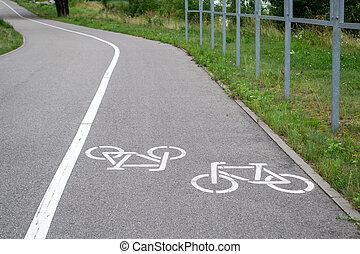 Bike symbol on asphalt. Bicycle road in city. Urban cycling.