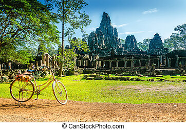 Bike tourist visiting Angkor Thom, one of the most famous temples of Angkor Wat, Cambodia
