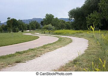 bike trail and horse riding or running track winding through...
