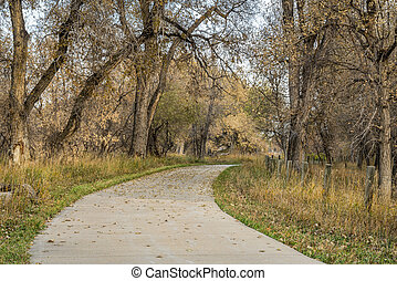 bike trail in late fall scenery along the Poudre River in...