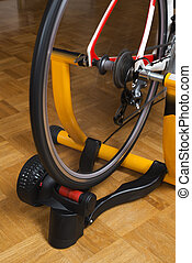 Home indoor training on a cycle trainer close up