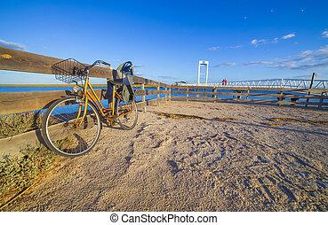 Bike with Child Bike Carrier beside Tavira Island drawbridge, Barril Beach, Portugal