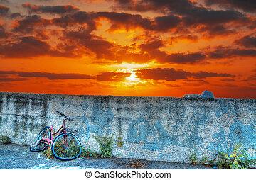 bike wreck at sunset