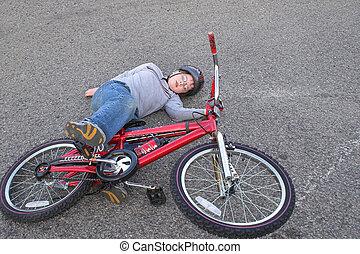 Bike Wreck - A young boy who crashed his bike.