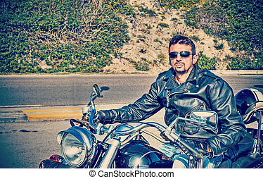 biker and his motorcycle in retro tone