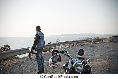 biker and motorcycle by the sea