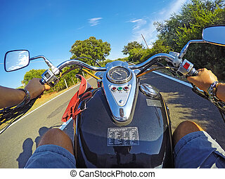biker and motorcycle on the road