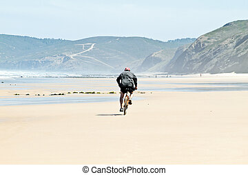 Biker at the beach