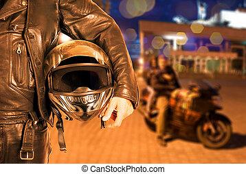 Biker closeup at night city background