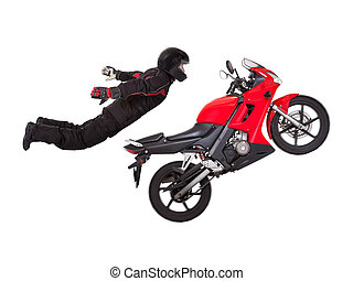 Young male biker in a helmet doing extreme jump stunt on his red motorcycle isolated on white