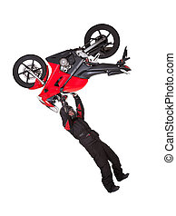 Biker doing extreme jump stunt on his motorcycle