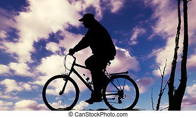biker, em, pôr do sol